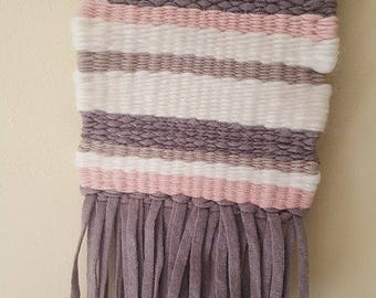 Small wall weaving taupe, ecru, pink tones.