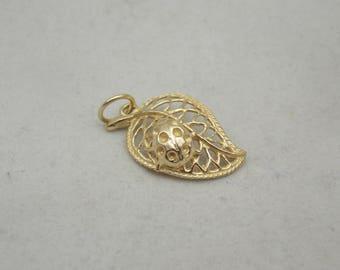 9 carat gold charm of a bug on a leaf