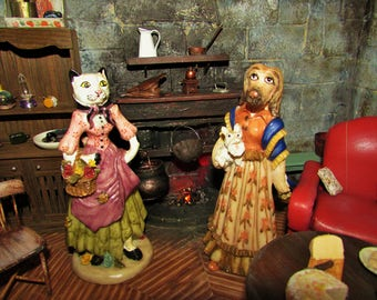 plastic cat and dog in peasant clothes vintage figurines
