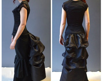 Tie on bustle, long black taffeta bustle worn as an over skirt