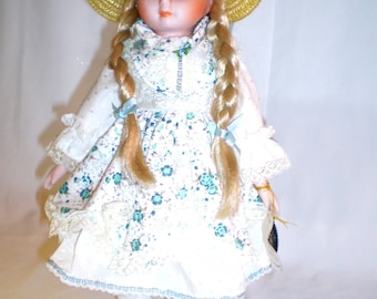 BRINNS Musical Authentic Collectible Porcelain Doll, Blond Braids and Hat, Plays HELLO DOLLY, Vintage 1986