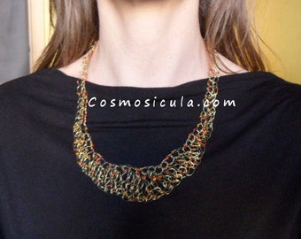 Wire crochet necklace. Crocheted with brass wire and beads. On request also available with copper wire or bleached brass wire.