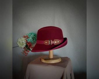 Maroon. Wine. Fedora. Wool. Bordeaux. Cloche. Hat. Felt. Red. Buckle.
