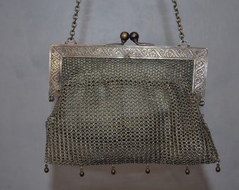 M F and CO. antique 1920s Chainmaille Mesh Purse. Ornate floral and ribbon frame. German Silver Faux Silver Beaded Purse.