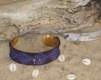 Bracelet with woven seed beads on brass