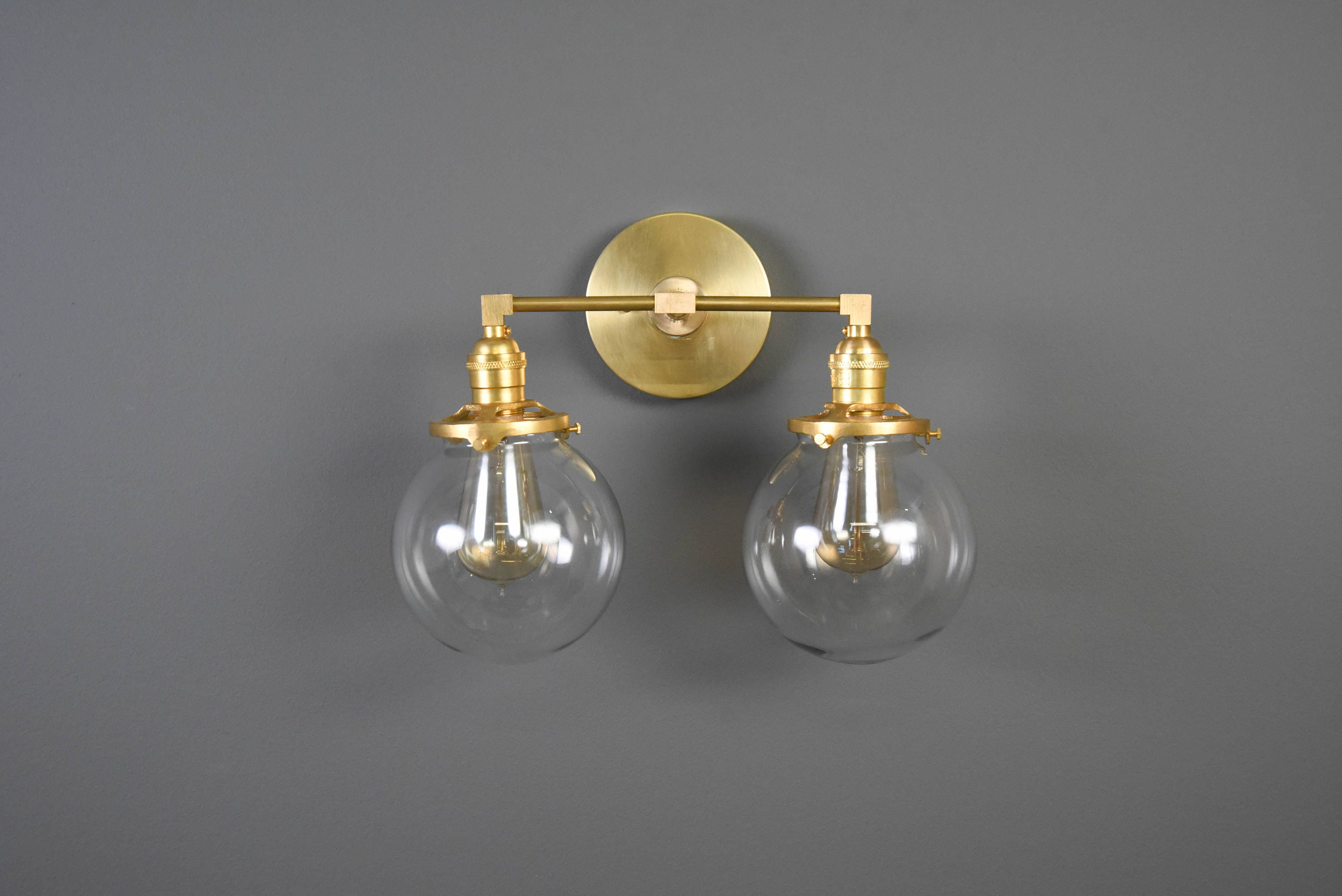horizontally in bathroom triple mirrors delphine two bulb bulbs pin custom this brass made is glass for sconce home with anywhere raw your globe or vertically seven duel hanging perfect and