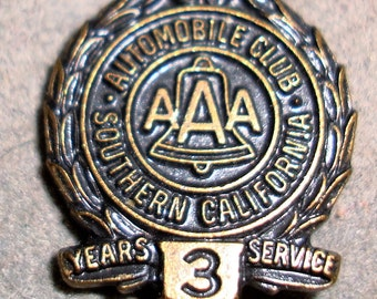 AUTO CLUB ofAMERICA, 3 year membership pin is about 1/2 inch diameter, it is made of blackened brass. Please see desccription .