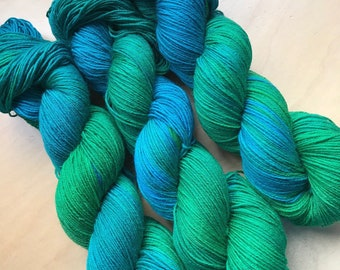Hand dyed sock weight yarn in the The Mother Island colourway