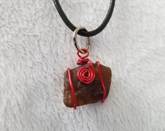 Brown sea glass with red wire