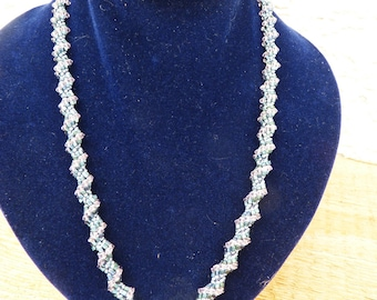 Collier, snake shape, supple for your neck, made of many tiny Swarovski beads