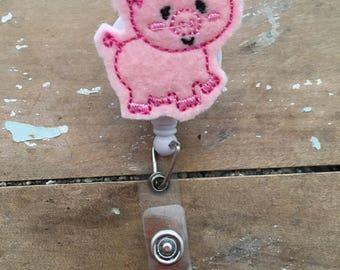 Pig ID badge reel holder retractable clip