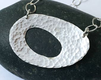 Hammered silver pod cutout necklace