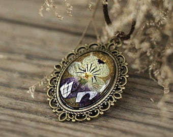 On sale Pansy Dried flower pendant lace flower necklace flowers in low dome glass cap than on olive a metal bezel bronze pendant