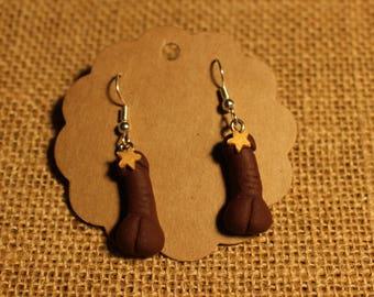 Censured black penis earrings