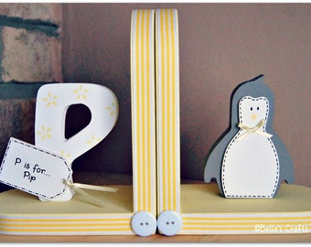 Personalised Penguin Bookends for children. Set of 2 bookends, one with a personalised initial another one with a Penguin.