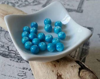 10 assorted glass beads round 8mm blue marbled appearance.