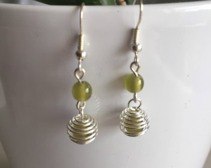 These earrings spiral khaki moss green beads