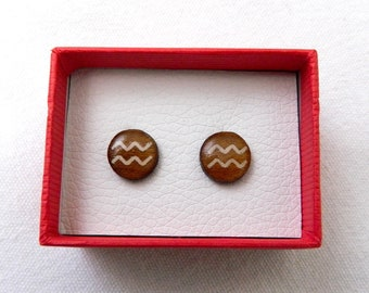 Zodiac earrings in lacquered wood.