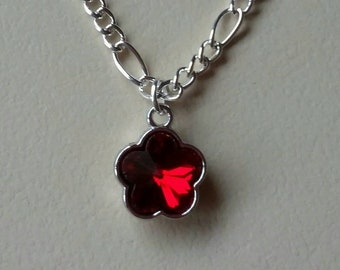 Silver necklace with red crystal flower charm