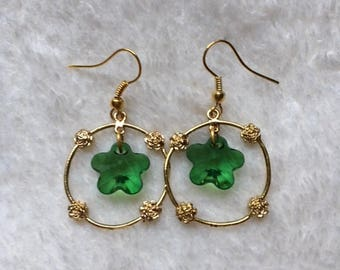Gold plated earrings with green flower