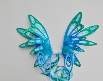 Delicious double turquoise, teal and white fairy wings with curly antennae.
