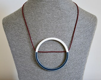 Statement blue, white and burgundy necklace circle pendant on stretch cord // large necklace // Scandinavian design // nautical / geometric