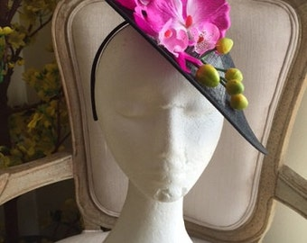 Pretty black hatinator with purple and white orchids on a headband. Gorgeous on!