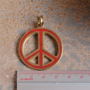 Peace sign pendant etsy brass peace sign pendant tibetan peace sign pendant nepal pendants turquoise peace sign mozeypictures Image collections