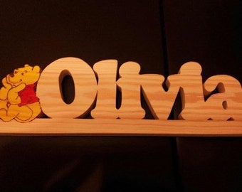 Hand made Woodart. Designed to order. ie names and decorative hangings