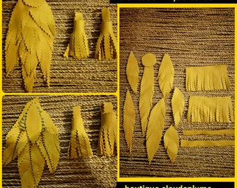 12 notched leaves & yellow leather fringe