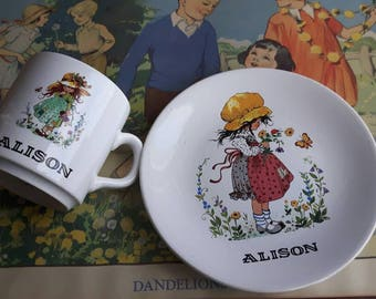 Vintage Hollie Hobbie style cup and side plate Alison made by purbeck ceramics 1970s.