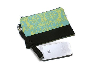 Floral iphone wristlet wallet with 2 zippered pockets and credit card slots; electric lime green/fresh mint. Monogrammed wristlet wallet.