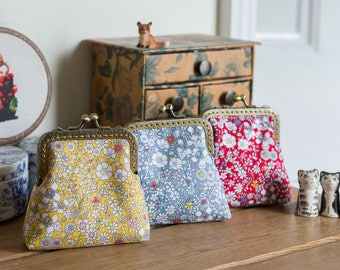 Coin purse made with Liberty cotton in the print: 'June's Meadow', a rich gold cotton lining, and hand stitched bronze metal frame