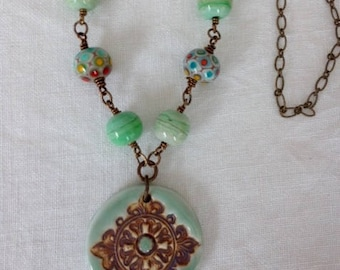 Baroque ceramic pendant, green artisan beads chain necklace