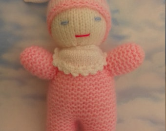 Pretty little pink hand knitted