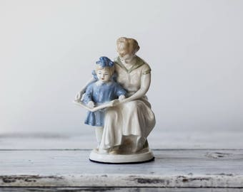 Porcelain statue of a woman with a child