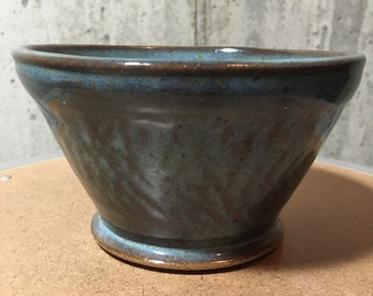 Turquoise bowl with chattering