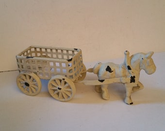 Reduced cast iron horse and cart