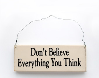 Wood sign saying: Don't Believe Everything You Think