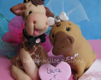 Giraffe and Platypus with personalized heart Animal Wedding Cake Topper