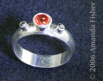 Halloween Ring with silver, orange sapphire, and black diamonds