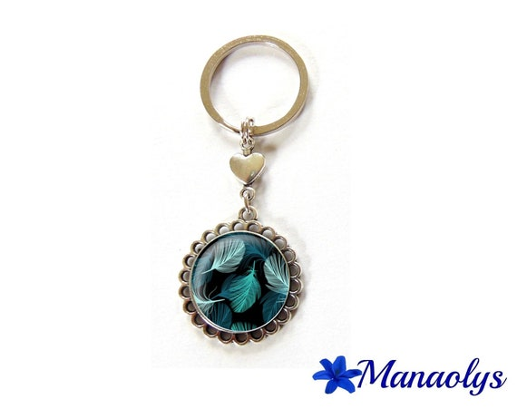 Door keys or bag charm blue feathers on black cabochon glass
