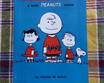 PEANUTS  Charlie Brown Snoopy We Are Right Behind You, Charlie Brown Softcover Book Charles Schultz 1964 !st Printing
