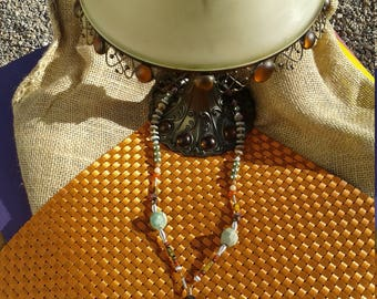 26 inch necklace featuring Jadeite Buddha.
