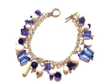 Bracelet.  Blue and White.  7.5 inches long. Charm Bracelet.