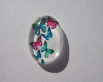 Glass cabochon oval 13 X 18 mm butterfly image with green and pink