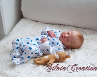 Logan reborn  kit by Denise Pratt.  Pictures are to show you how reborn baby can look when completed.  You are not buying a completed doll.