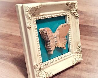 3D butterfly in frame
