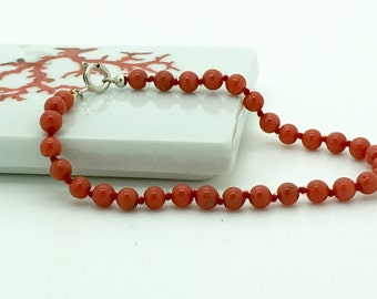 woman in red coral bracelet Corsica 1st choice