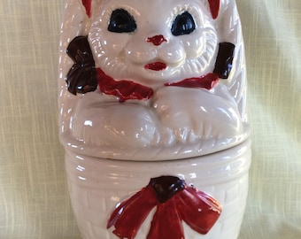 Early American bisque cookie jar canister kitchen storage cat in a basket